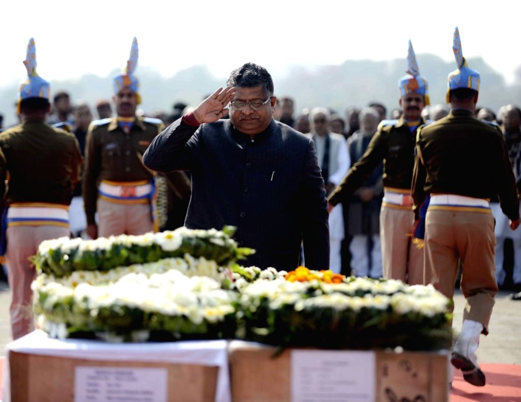 Union Law Minister Ravi Shankar Prasad pays tribute to martyrs Ratan Kumar Thakur and Sanjay Kumar Sinha, who were among the 45 CRPF personnel killed in 14 Feb Pulwama militant attack, in ... - Ravi Shankar Prasad, Kumar Thakur and Sanjay Kumar Sinha
