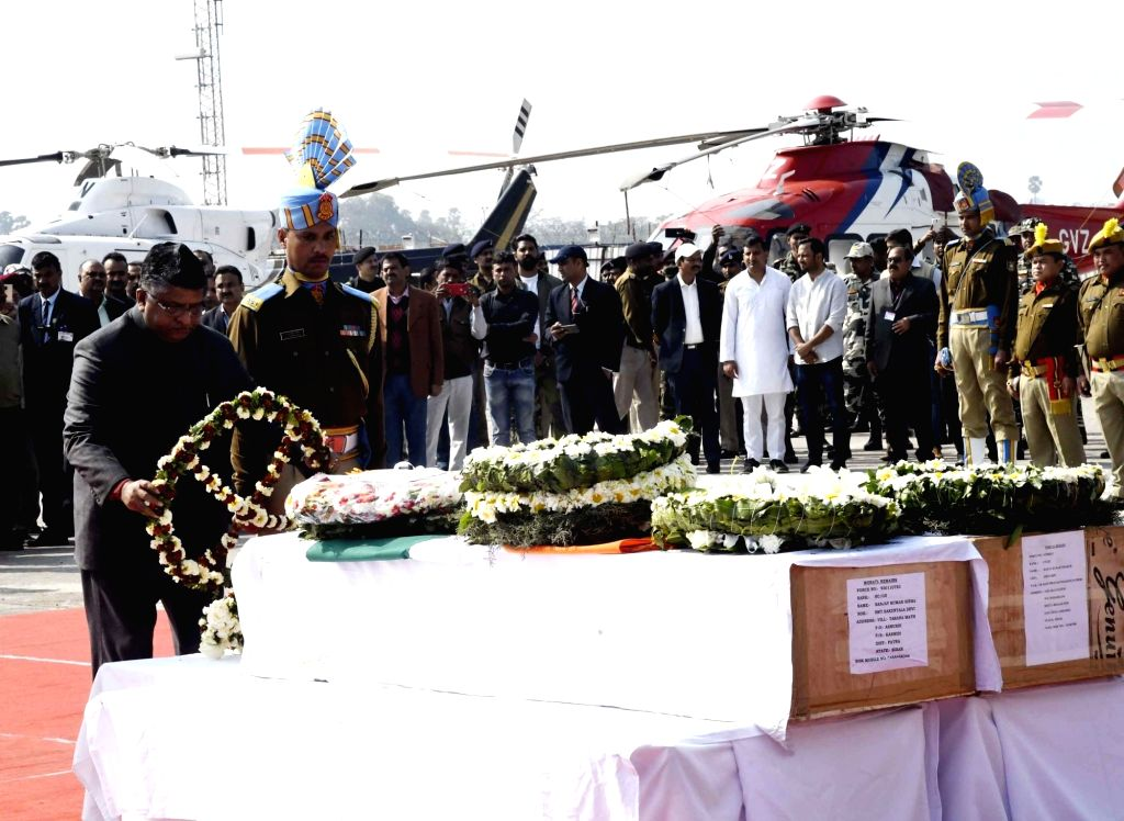 Union Law Minister Ravi Shankar Prasad pays tribute to martyrs Ratan Kumar Thakur and Sanjay Kumar Sinha, who were among the 49 CRPF personnel killed in 14 Feb Pulwama militant attack, in ... - Ravi Shankar Prasad, Kumar Thakur and Sanjay Kumar Sinha