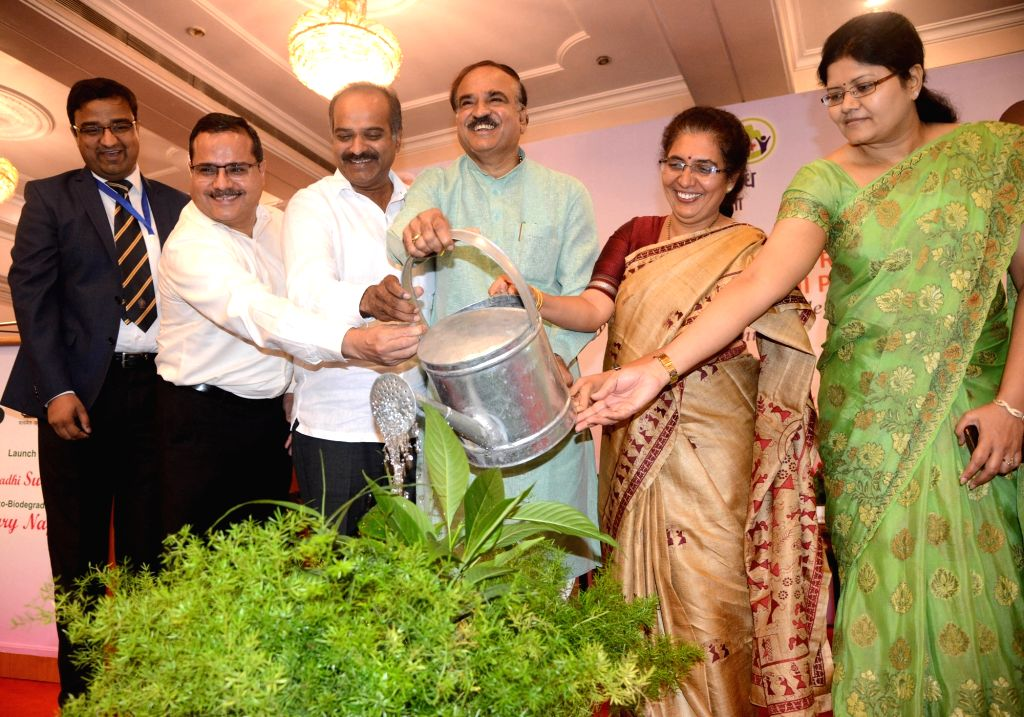 Union Minister Ananth Kumar along with Adamya Chetana Founder Tejaswini Ananth Kumar and other dignitaries, waters the plants during the launch of Janaushadhi Suvidha Oxo-biodegradable ... - Ananth Kumar