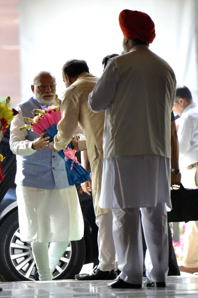 Union Minister Ananth Kumar greets Prime Minister Narendra Modi during the BJP Parliamentary party meeting at Parliament house library, in New Delhi on March 16, 2017. - Ananth Kumar and Narendra Modi