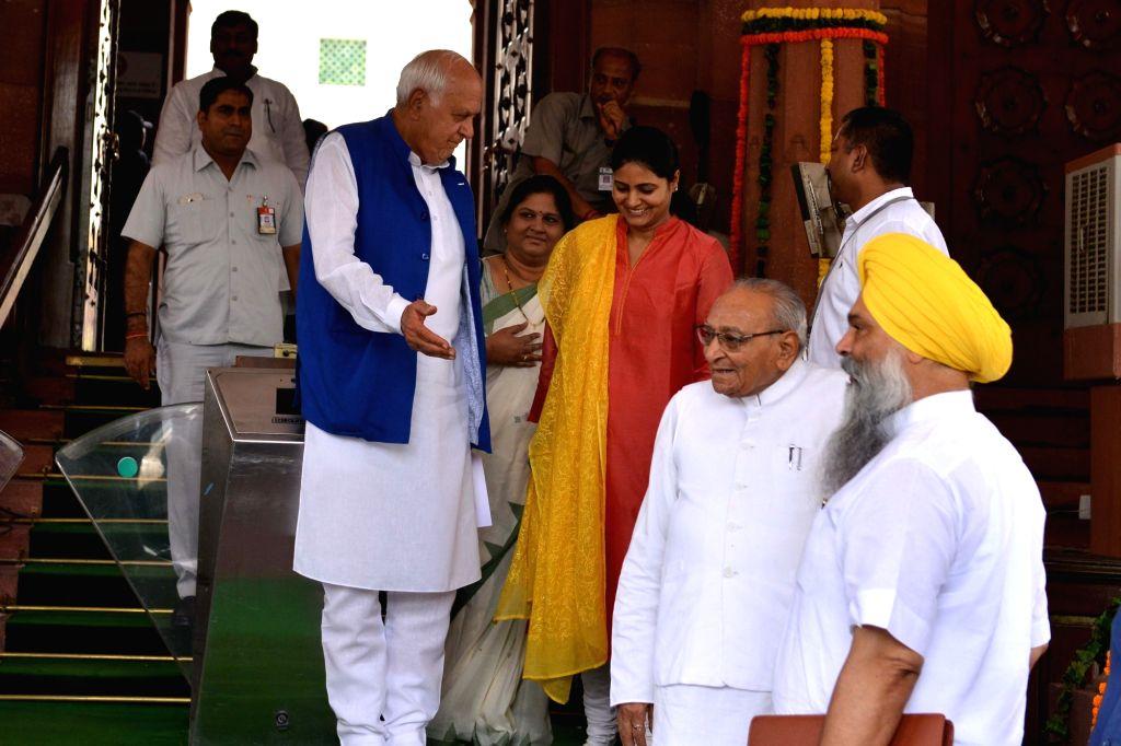 Union Minister and Apna Dal MP Anupriya Patel, Congress MP Motilal Vora and National Conference MP Farooq Abdullah at Parliament, in New Delhi on Aug 1, 2018. - Anupriya Patel