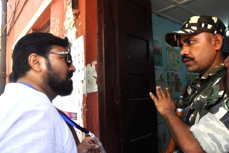 Union Minister and Bharatiya Janata Party (BJP) candidate Babul Supriyo confronts a security personnel after his car was vandalised during the fourth phase of 2019 Lok Sabha elections, in ...