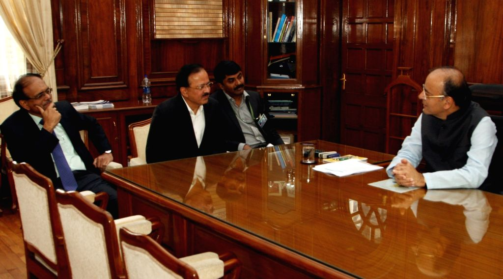 Union Minister and BJP leader Arun Jaitley interacts with Minister of State for Defence Dr. Subhash Bhamre at South Block after taking over additional charge as Union Defence Minister, in ... - G Satheesh Reddy and Arun Jaitley