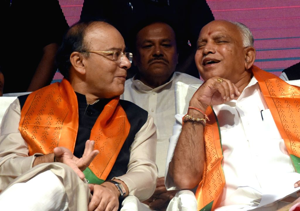 Union Minister and BJP leader Arun Jaitley with Karnataka BJP  chief B. S. Yeddyurappa during a programme organised to celebrate three years of the NDA Government in Bengaluru on May 28, ... - Arun Jaitley