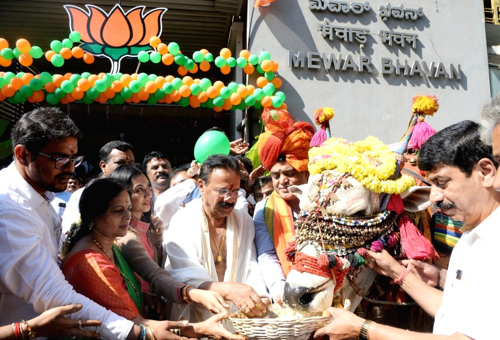 Union Minister and BJP leader D. V. Sadananda Gowda performs 'Gau puja' at the inauguration of the party's Bangalore North Lok Sabha constituency election office at Yeshwanthpura in ...