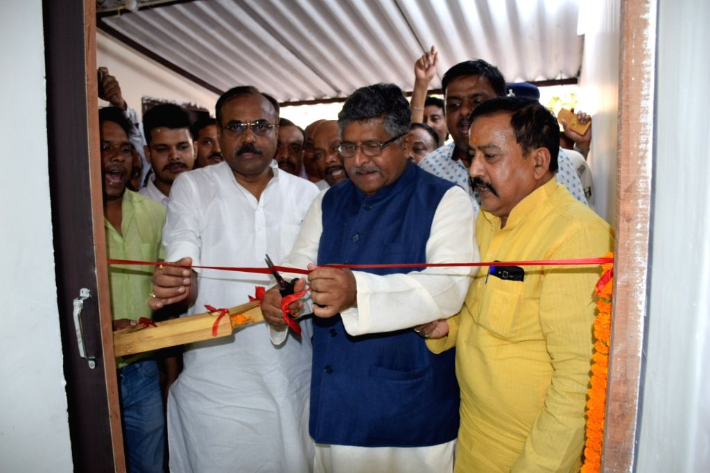 Union Minister and BJP leader Ravi Shankar Prasad cuts the ribbon to inaugurate the party office at Digha in Patna, on April 25, 2019.