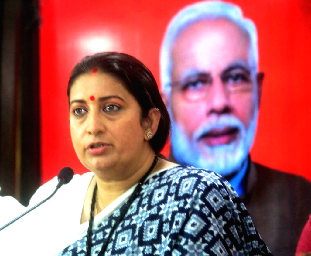 Union Minister and BJP leader Smriti Irani addresses a press conference in Hyderabad on Nov 25, 2020. Union minister of Textiles Smriti Irani on Wednesday alleged that the 'unholy' ... - Smriti Irani