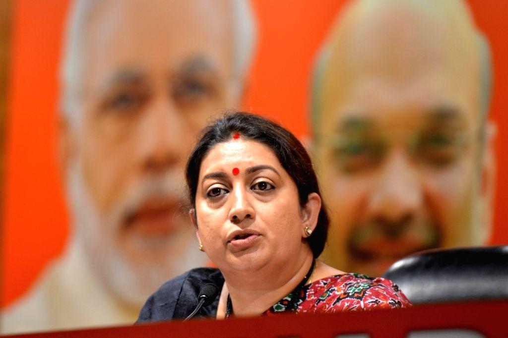 Union Minister and BJP leader Smriti Irani addresses a press conference in New Delhi, on March 13, 2019. - Smriti Irani