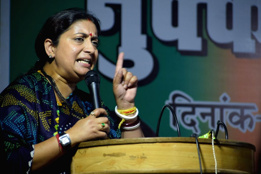 Union Minister and BJP leader Smriti Irani addresses at a public meeting in Uttar Pradesh's Ramnagar, on May 10, 2019. - Smriti Irani