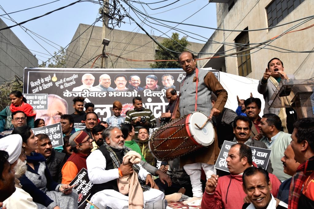 "Union Minister and BJP leader Vijay Goel participates in the party's ""Dhol Andolan"" in New Delhi, on Feb 3, 2019."