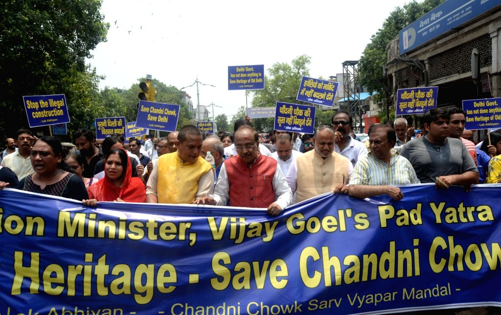 """Union Minister and BJP leader Vijay Goel leads a """"Save Heritage"""" march to protest against the illegal construction in Delhi's Chandni Chowk area; in New Delhi on July 5, 2018."""