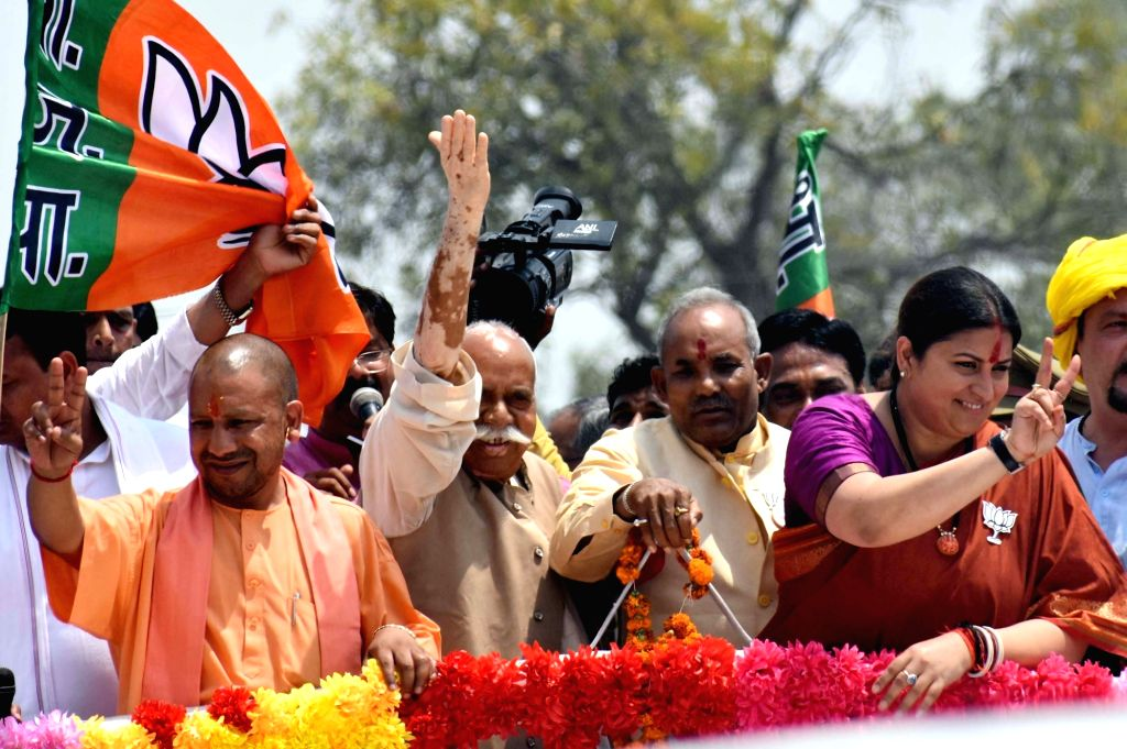 Union Minister and BJP's Lok Sabha candidate from Amethi, Smriti Irani accompanied by Uttar Pradesh Chief Minister Yogi Adityanath, during a road show ahead of filing her nomination for the ... - Yogi Adityanath and Smriti Irani