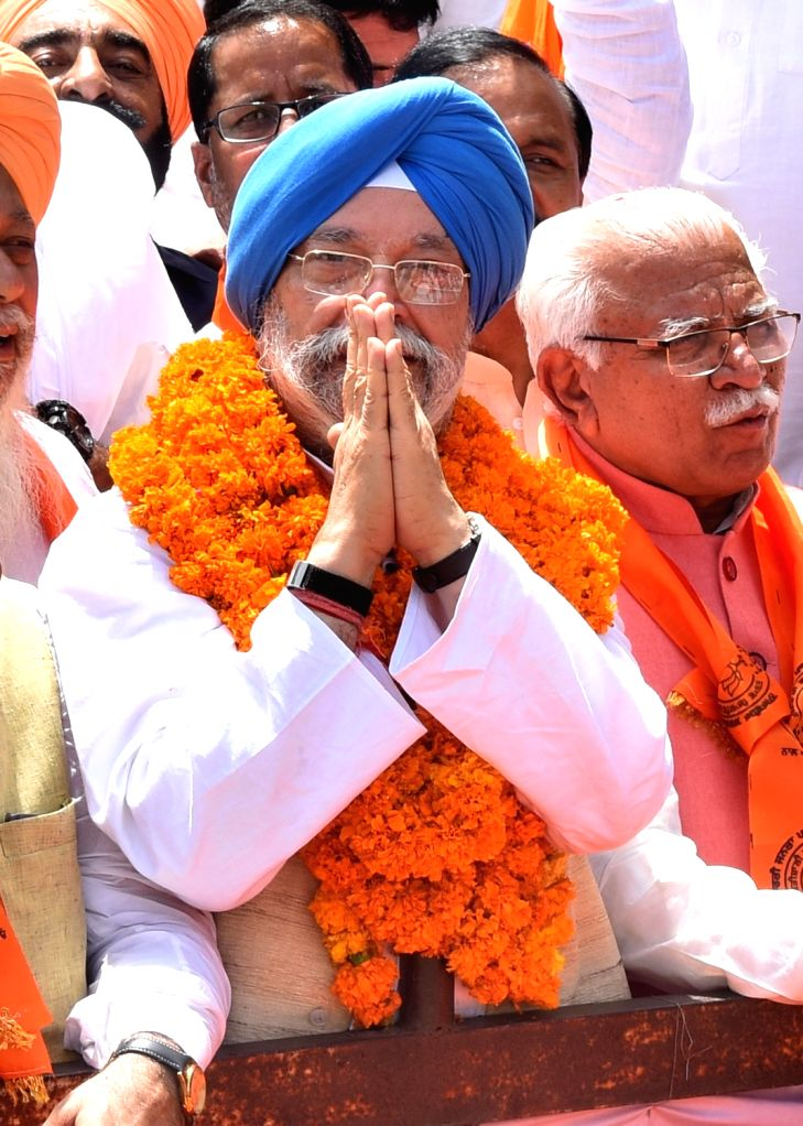 Union Minister and BJP's Lok Sabha candidate from Amritsar,  Hardeep Singh Puri during a roadshow ahead of filing his nomination for the 2019 Lok Sabha elections, in Amritsar on April 26, ... - Hardeep Singh Puri