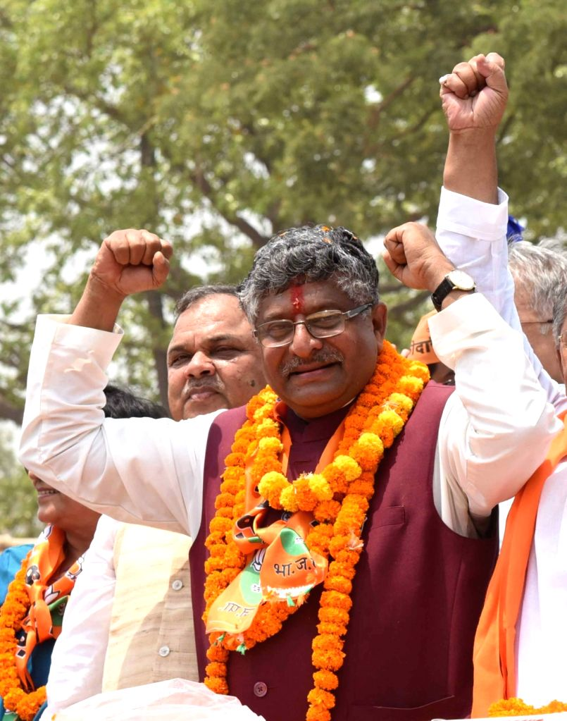 Union Minister and BJP's Lok Sabha candidate from Patna Sahib, Ravi Shankar Prasad during a roadshow ahead of filing his nomination for the forthcoming Lok Sabha elections, in Patna on April ...