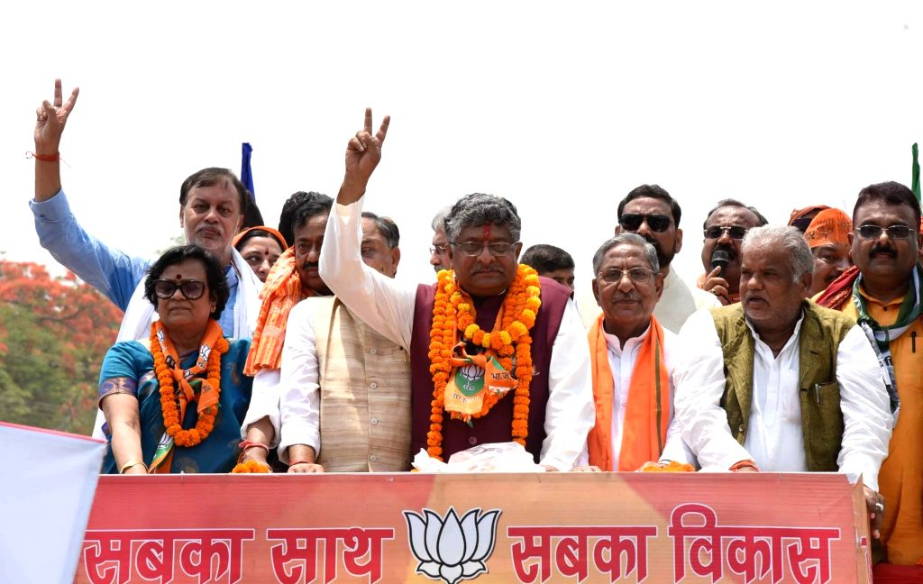Union Minister and BJP's Lok Sabha candidate from Patna Sahib, Ravi Shankar Prasad with Bihar Minister Nand Kishore Yadav, during a roadshow ahead of filing his nomination for the forthcoming ... - Nand Kishore Yadav