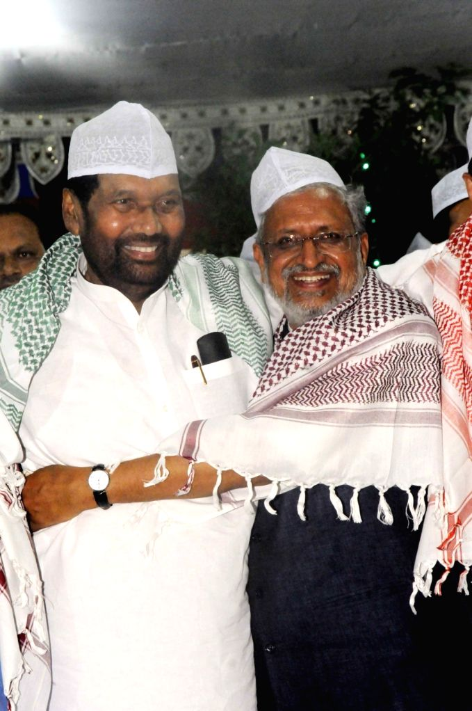 Union Minister and Lok Janshakti party Chief Ram Vilas Paswan and BJP leader Sushil Kumar Modi during at an Iftaar party hosted by the latter in Patna on June 24, 2017. - Sushil Kumar Modi