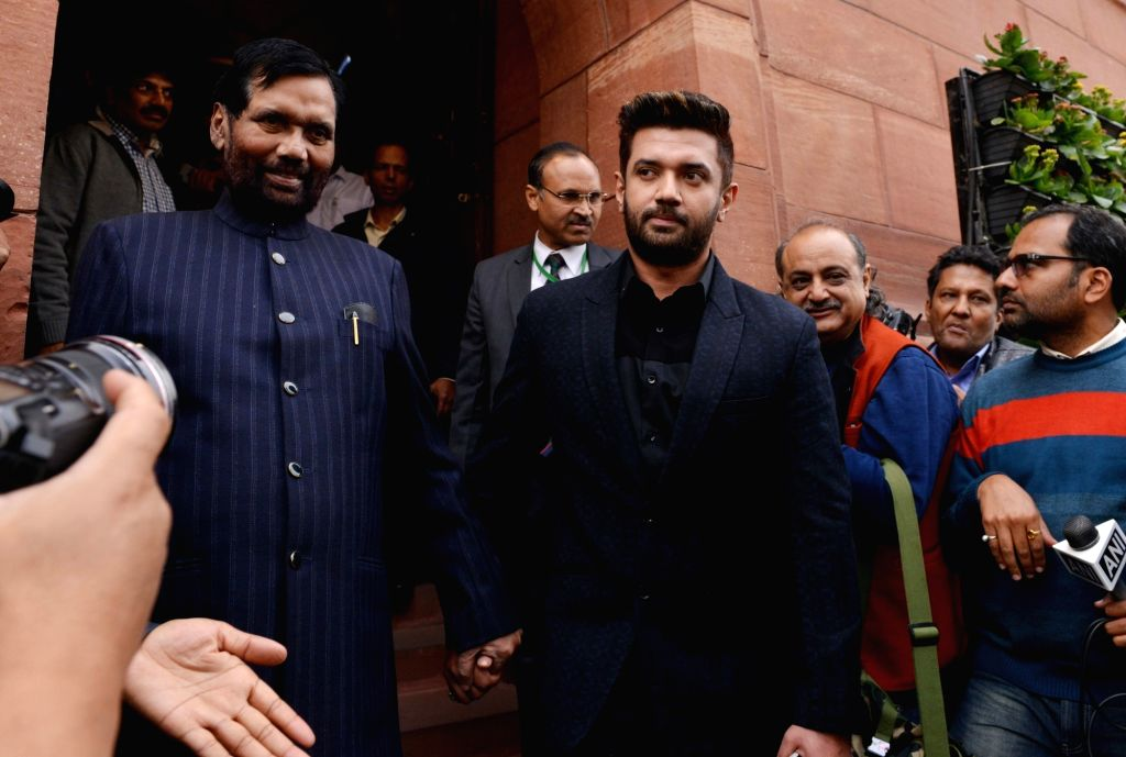 Union Minister and Lok Janshakti Party (LJP) MP Ram Vilas Paswan with his son and party MP Chirag Paswan at the winter session of Parliament in New Delhi on Dec 11, 2018.