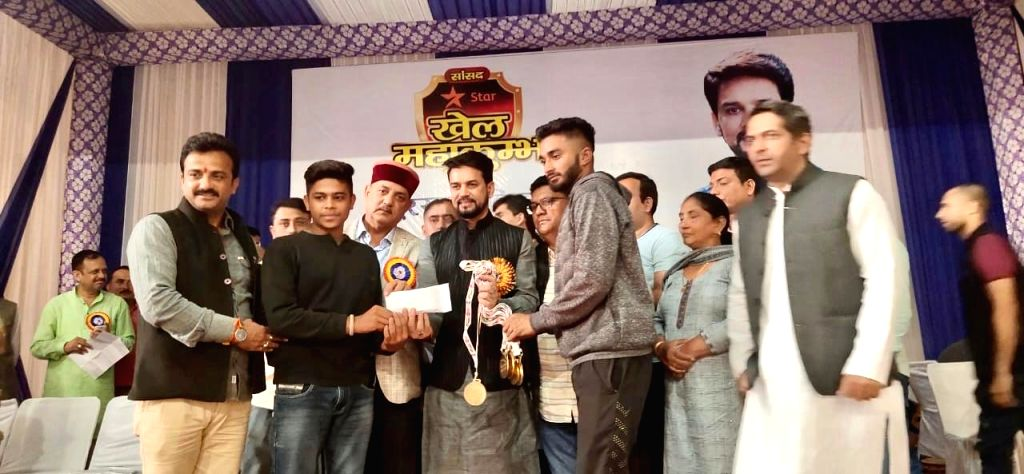 Union Minister Anurag Thakur gives away prizes to athletes during Sansad Star Khel Mahakumbh final prize distribution ceremony in Shimla on Oct 26, 2019. - Anurag Thakur