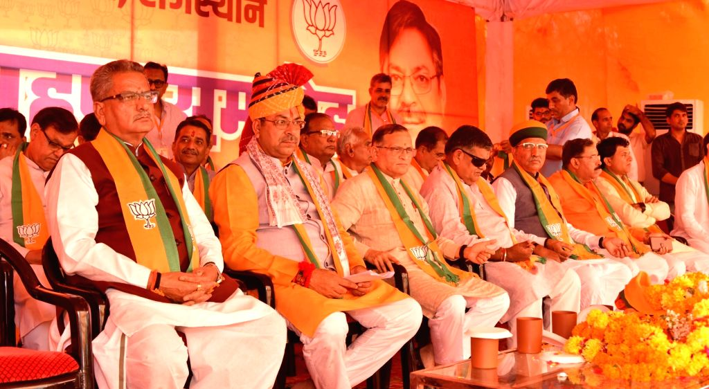 Union Minister Arjun Ram Meghwal, BJP leader Satish Poonia and other party leaders during a programme where Poonia took charge as the party's Rajasthan unit President in Jaipur on Oct 8, 2019. - Arjun Ram Meghwal