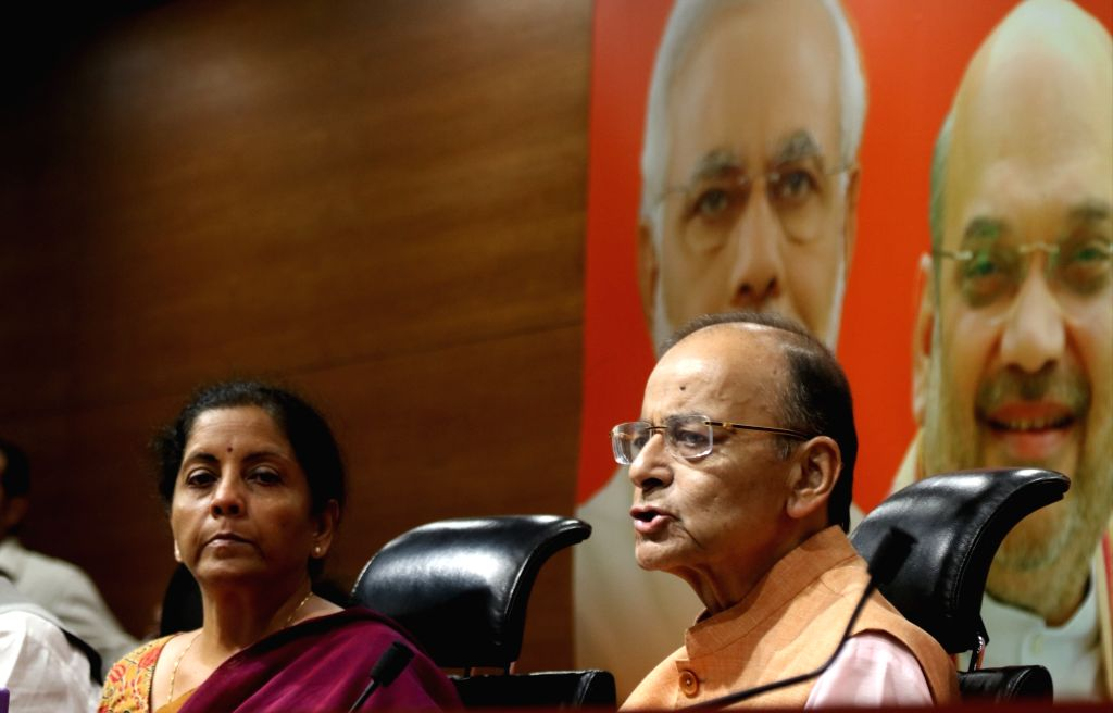 Union Minister Arun Jaitley accompanied by Cabinet Minister Nirmala Sitharaman, addresses a press conference at the BJP's headquarter in New Delhi, on May 2, 2019. - Arun Jaitley