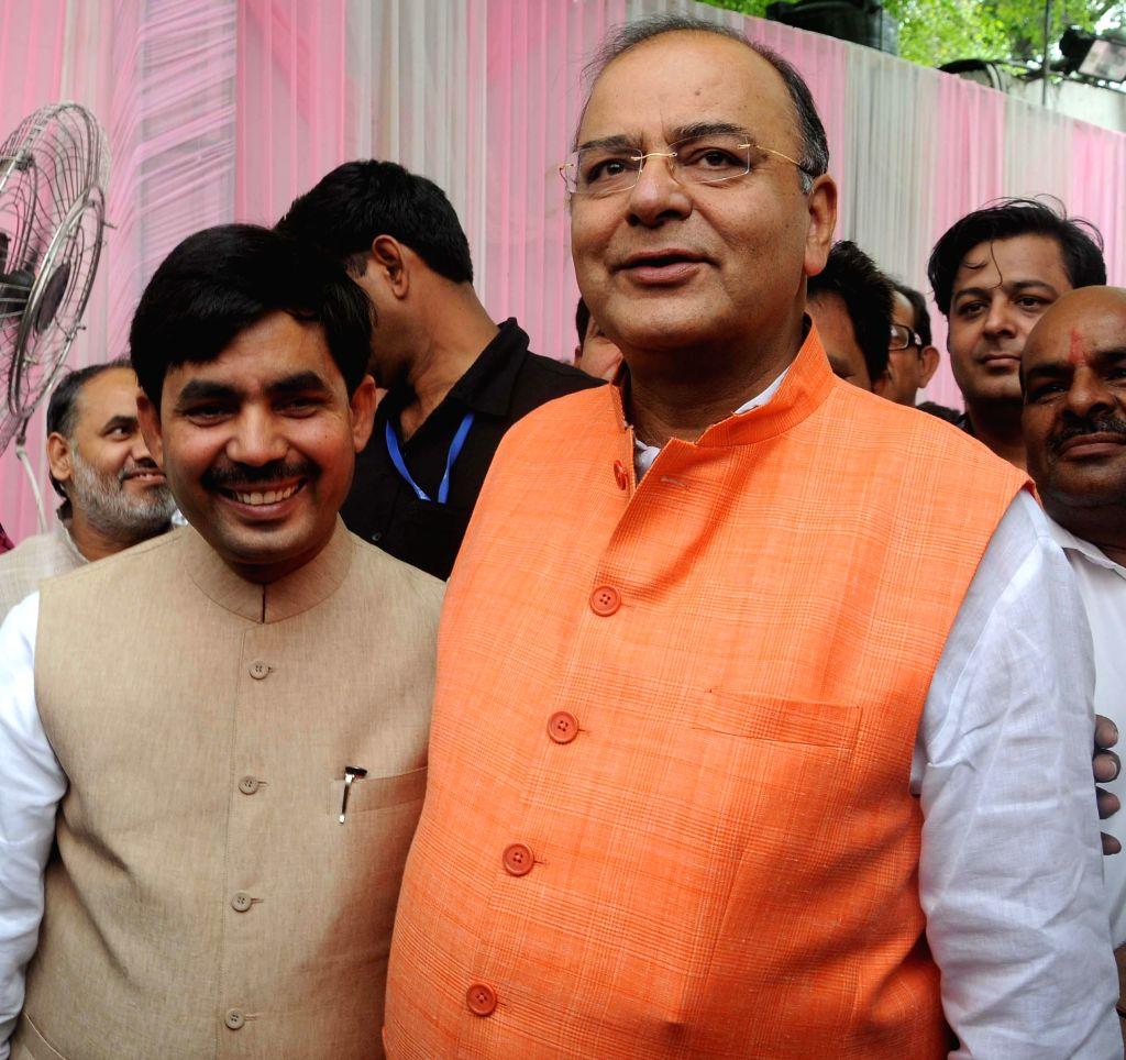 Union Minister Arun Jaitley greets BJP senior leader Shahnawaz Hussain on the occasion of Eid ul-Fitr in New Delhi on July 29, 2014. - Arun Jaitley