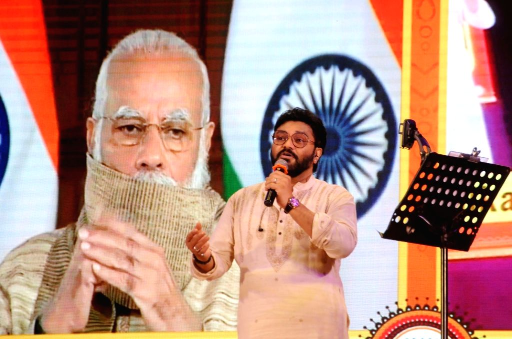 Union Minister Babul Supriyo addresses at the inauguration of Durga Puja celebrations by Prime Minister Narendra Modi, jointly organised by the BJP Mohila Morcha and the party's Cultural ... - Babul Supriyo and Narendra Modi