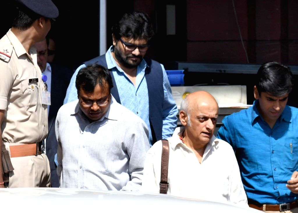 Union Minister Babul Supriyo and film producer Mukesh Bhatt come out after meeting Union Home Minister Rajnath Singh at North Block in New Delhi on Oct 20, 2016. - Babul Supriyo and Rajnath Singh