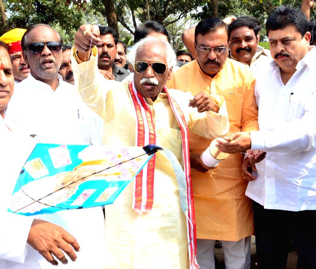 Union Minister Bandaru Dattatrey flies kite on the eve of Makar Sankranti in Hyderabad on Jan 13, 2017. - Bandaru Dattatrey