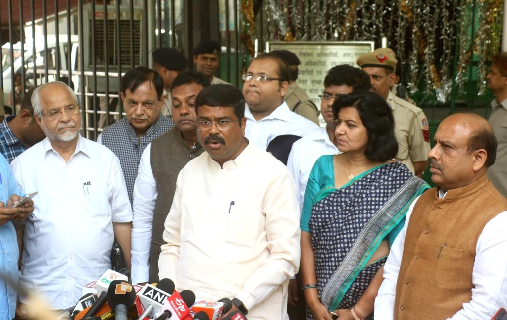 Union Minister Dharmendra Pradhan accompanied by BJP leaders Sambit Patra and Vijender Gupta, addresses a press conference after meeting the Chief Election Commissioner (CEC) in New Delhi, ... - Dharmendra Pradhan and Vijender Gupta