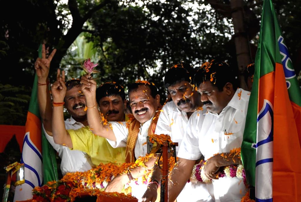 Union Minister DV Sadananda Gowda being welcomed BJP workers on his arrival in Bengaluru on June 1, 2019. - D