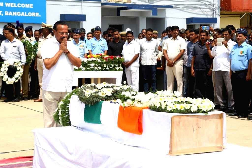 Union Minister DV Sadananda Gowda pays tribute to Guru H who was among the 45 CRPF personnel killed 14 Feb Pulwama militant attack, in Bengaluru on Feb 16, 2019. - D