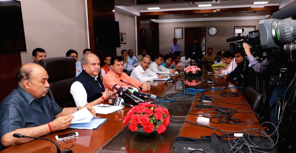Union Minister for Agriculture & Farmers Welfare, Rural Development and Panchayati Raj Narendra Singh Tomar addresses a press conference, in New Delhi on Aug 9, 2019. Also seen ... - Welfare Kailash Choudhary