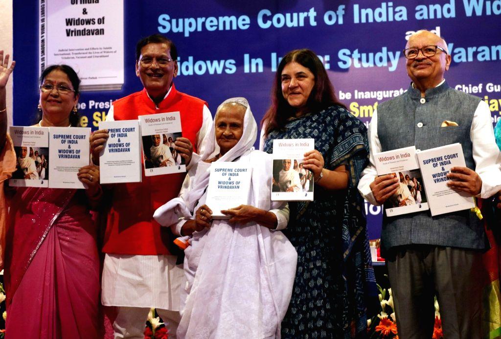 "Union Minister for Child and Women development Maneka Gandhi and Sulabh Foundation founder Bindeshwar Pathak unveil books on ""Supreme Court of India & Widows of Vridavan"" and ... - Maneka Gandhi and Bindeshwar Pathak"