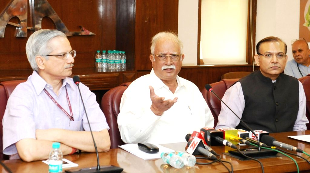 Union Minister for Civil Aviation Ashok Gajapathi Raju addresses a press conference in New Delhi on June 24, 2017. Also seen Minister of State for Civil Aviation Jayant Sinha and Ministry ... - Aviation Jayant Sinha