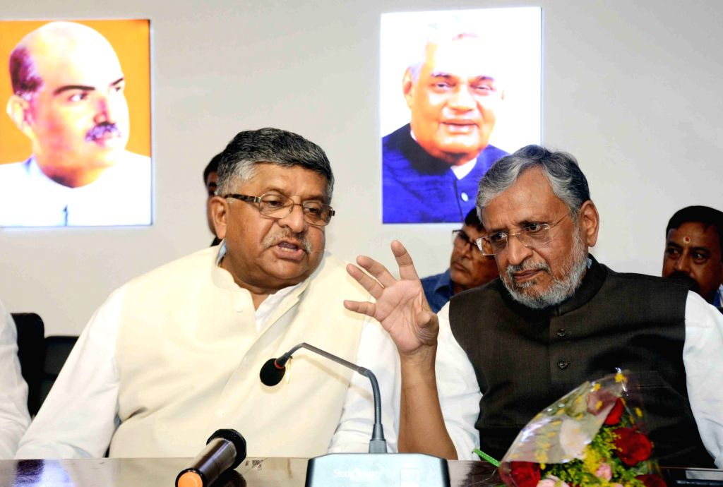 Union Minister for Communications, Electronics and Information Technology Ravi Shankar Prasad interacts with Bihar Deputy Chief Minister Sushil Modi during the blood donation camp organised by ... - Sushil Modi