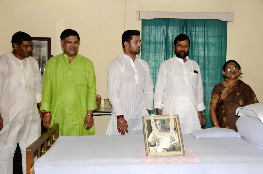 Union Minister for Consumer Affairs, Food and Public Distribution Ramvilas Paswan with Jamui MP and son Chirag Paswan pay tribute to socialist leader Jayaprakash Narayan at his residence on ... - Indira Gandhi
