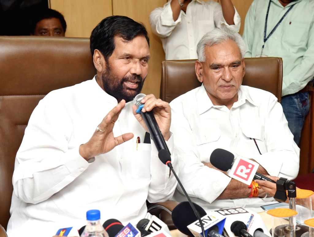 Union Minister for Consumer Affairs, Food and Public Distribution Ram Vilas Paswan addresses a press conference in New Delhi on July 7, 2017. Also seen Minister of State for Consumer ...