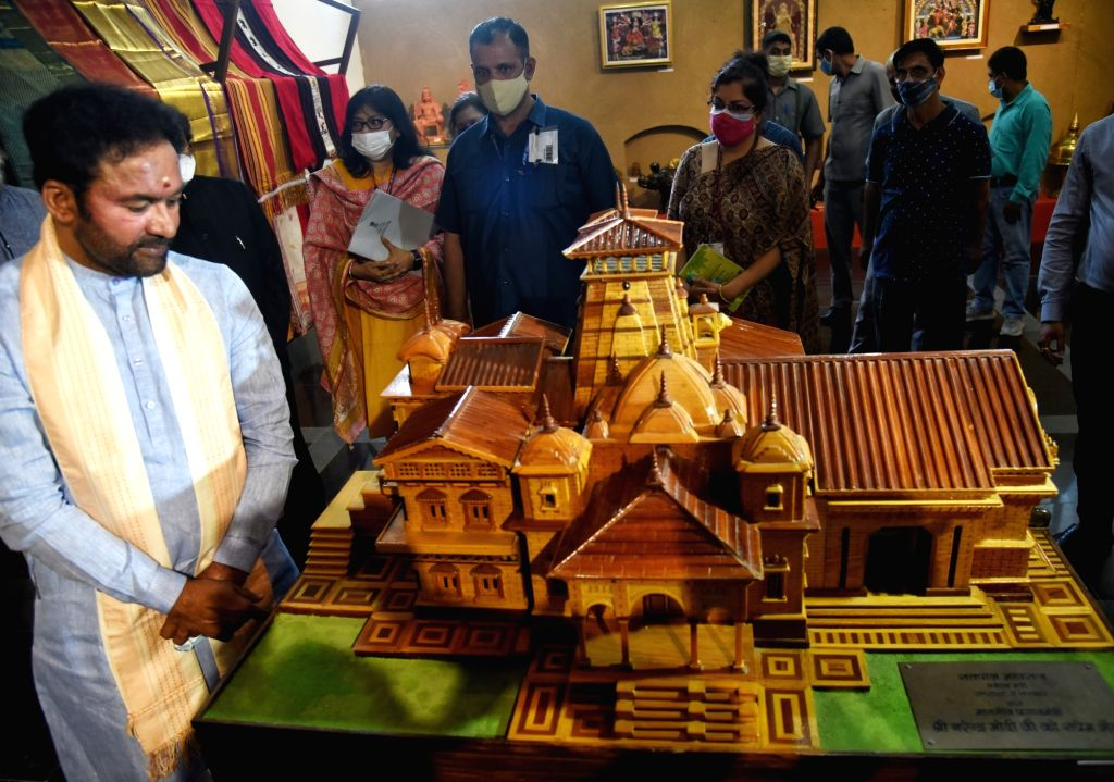 Union Minister for Culture and Tourism G Kishan Reddy look Mementos given by others to Prime Minister Narendra Modi displayed at National Gallery of Modern Arts for e Auction in New Delhi on ... - Narendra Modi and G Kishan Reddy