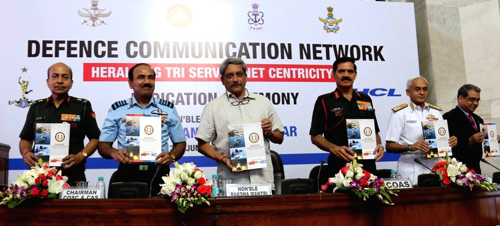 Union Minister for Defence Manohar Parrikar release a telephone directory of the Defence Communication Network (DCN) subscribers, at the Dedication Ceremony of the Defence Communication ... - Dalbir Singh and Nitin Kohli