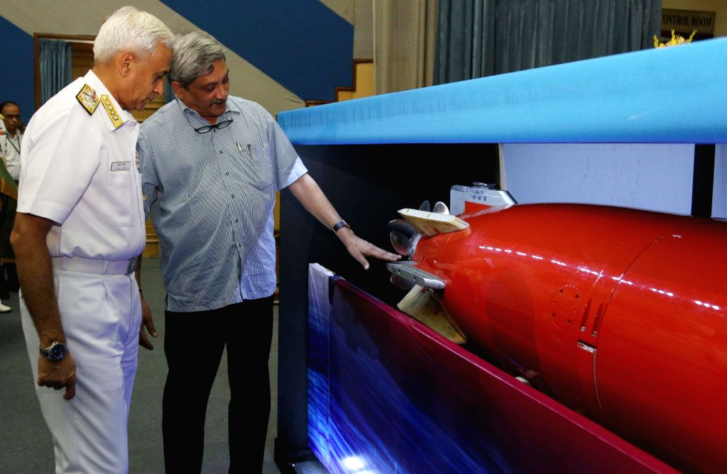 Union Minister for Defence Manohar Parrikar and the Chief of Naval Staff, Admiral Sunil Lanba taking a close look at the 'Varunastra' torpedo, during the Handing Over Ceremony of ...