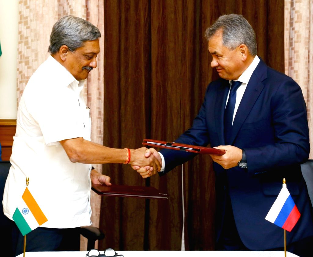 Union Minister for Defence Manohar Parrikar and his Russian counterpart General Sergey Shoigu exchangs the protocol document after the 16th meeting of the India-Russia Intergovernmental ...