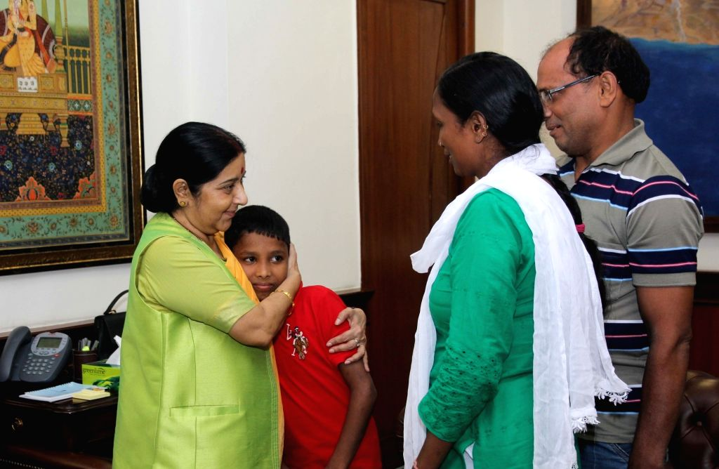 Union Minister for External Affairs Sushma Swaraj welcomes home Sonu, the Indian boy who went missing from Delhi six years ago and was traced in Bangladesh in New Delhi on June 30, 2016. - Sushma Swaraj