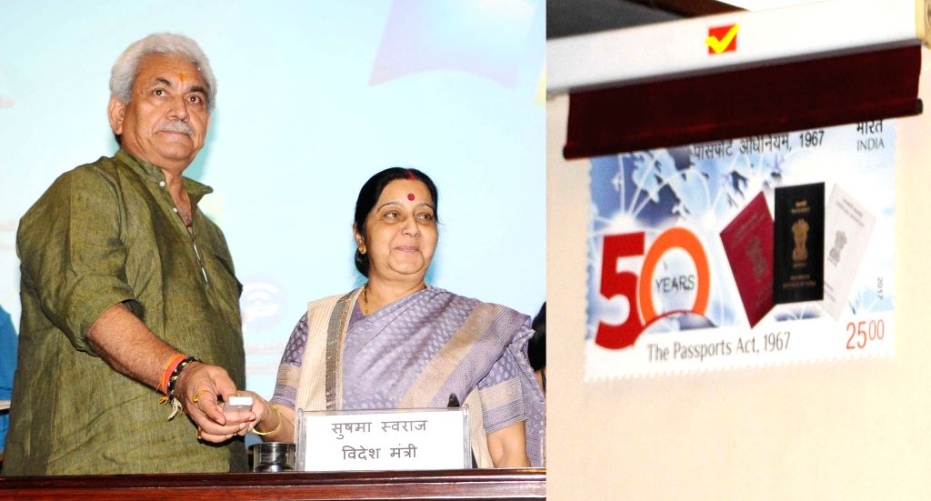 Union Minister for External Affairs Sushma Swaraj and Minister of State for Communications (Independent Charge) and Railways Manoj Sinha release the commemorative postage stamp to mark the ... - Sushma Swaraj and Manoj Sinha