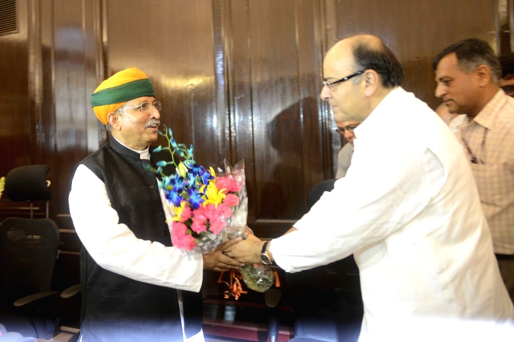 Union Minister for Finance and Corporate Affairs Arun Jaitley greets Arjun Ram Meghwal as he takes charge as the Ministers of State for Finance, in New Delhi on July 6, 2016. - Affairs Arun Jaitley