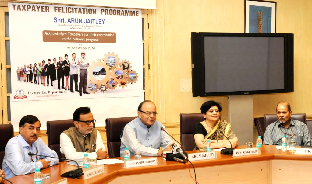 Union Minister for Finance and Corporate Affairs Arun Jaitley addresses at the Taxpayer felicitation programme in New Delhi on Sept 19, 2016. Also seen Revenue Secretary, Dr. Hasmukh Adhia ... - Affairs Arun Jaitley