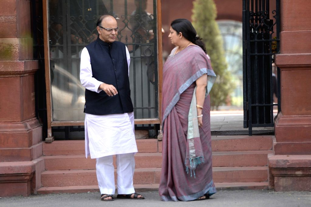 Union Minister for Finance and Corporate Affairs Arun Jaitley and Union Textiles Minister Smriti Irani come out after Cabinet Meeting at South Block in New Delhi on Sept 28, 2016. - Smriti Irani and Affairs Arun Jaitley
