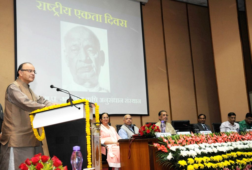 Union Minister for Finance and Corporate Affairs Arun Jaitley addresses after making a field visit of new varieties of pulses on the occasion of the Rashtriya Ekta Diwas in New Delhi on ... - Affairs Arun Jaitley