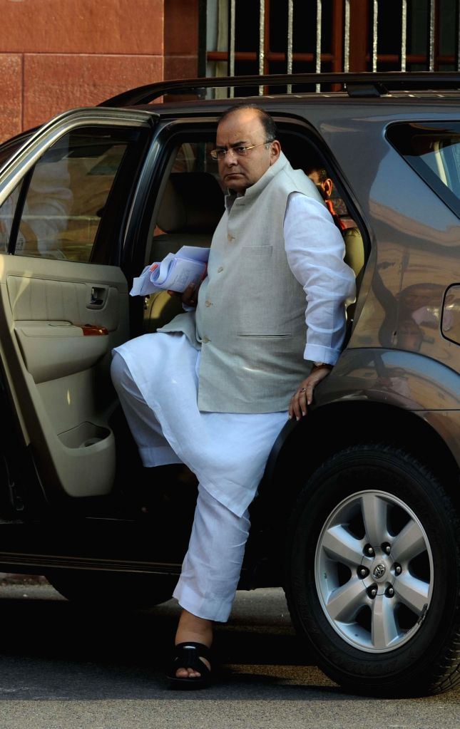 Union Minister for Finance, Corporate Affairs and Defence Arun Jaitley arrives at the Parliament in New Delhi on Aug 13, 2014. - Arun Jaitley