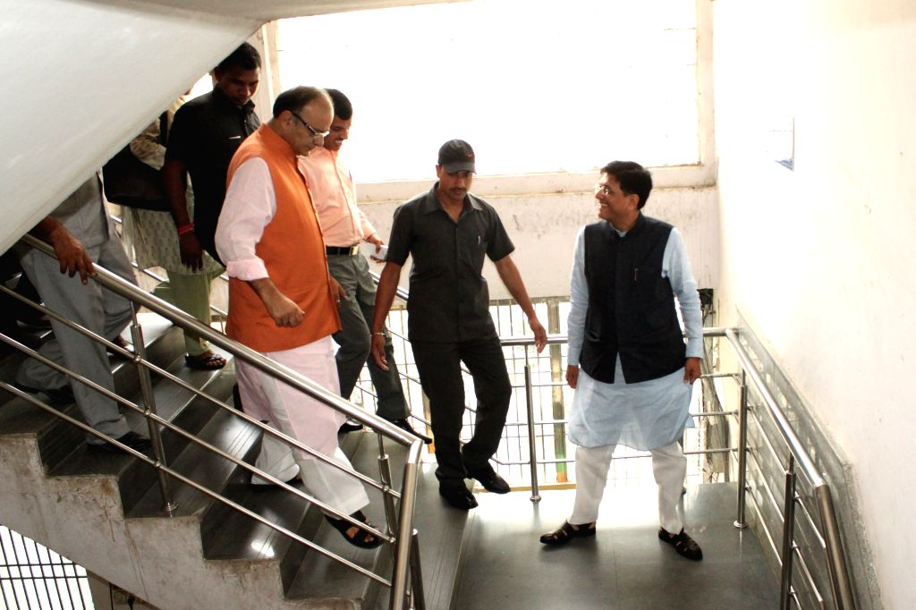 Union Minister for Finance, Corporate Affairs and Information and Broadcasting Arun Jaitley and Minister of State (Independent Charge) for Power, Coal and New and Renewable Energy Piyush ...