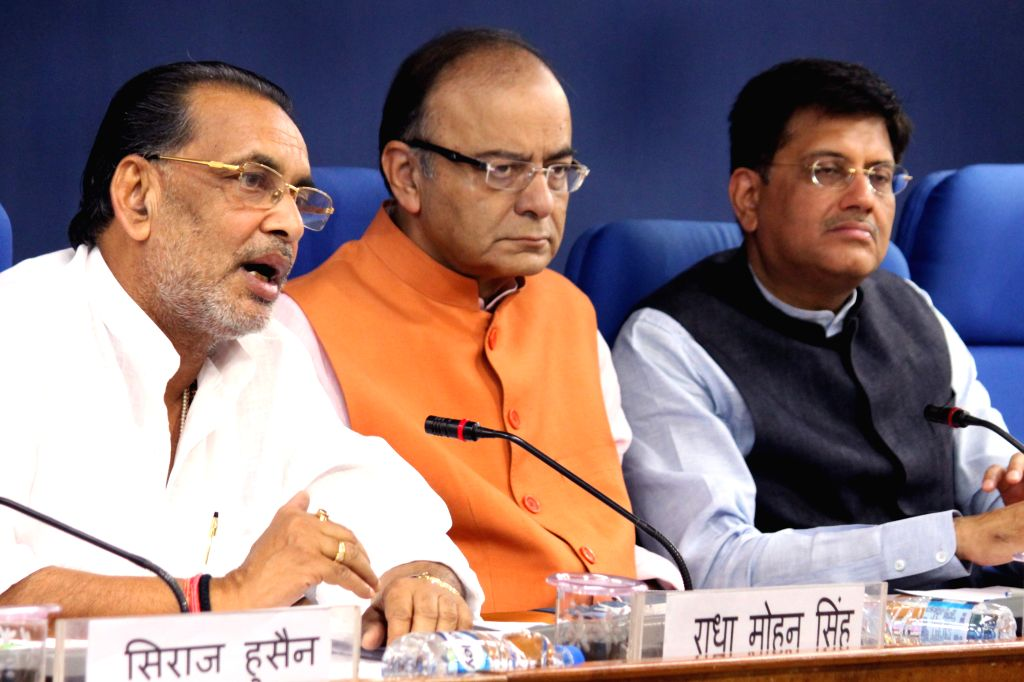 Union Minister for Finance, Corporate Affairs and Information and Broadcasting Arun Jaitley, Union Agriculture Minister Radha Mohan Singh and Minister of State (Independent Charge) for ... - Radha Mohan Singh